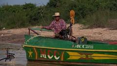 IMGP1380 Going Fishing (Claudio e Lucia Images around the world) Tags: kompongphlukfloatingvillage siemreap cambodia kompong pluck floating village siem reap cambogia people portrait man pentax pentaxart pentaxkp pentax18135 pentaxlens boat river water mud kampong