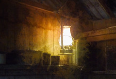 The Lamplight's Glow (Steve Taylor (Photography)) Tags: lamplight tins barn digitalart farm lamp hut shed brown yellow white shelf wooden newzealand nz southisland canterbury christchurch glow