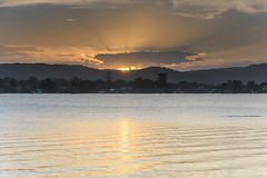Sunset over the Bay with High Cloud (Merrillie) Tags: daleyspoint blackwall landscape sunset nature australia mountains gold evening blue rocks golden sun brisbanewater crepuscularrays sunrays bookerbay sthubertsisland clouds coastal twilight outdoors waterscape sea centralcoast bay water