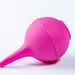 Pink enema bulb on white. Medical children's enema