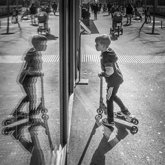 No Food, Drinks And Micro Scooters Allowed Inside. (Markus Binzegger) Tags: blackandwhite blacknwhite blackwhite bnwstreet bwstreet decisivemoment magnumphotos monochrome photography photostreet street streetbnw streetphotographer streetphotography streetbw streetphotobnw streetphotobw streetphotographybw streetphotographers streetphotos streetscene streetshot topbnw reflection scooter boy microscooter