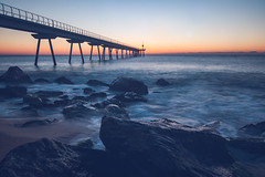 (Xavier Larrosa) Tags: sunrise sunset amanecer atardecer playa beach mar sea pont puente bridge sun sol water agua rocas rocks badalona pontdelpetroli