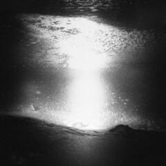 Silver Lake in Winter #35 (LowerDarnley) Tags: holga winter silverlake frozen ice sun reflection shore rocks saugus ma breakheartreservation explosion blast