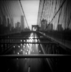 Brooklyn Bridge (Zeb Andrews) Tags: holga kodaktrix newyork newyorkcity brooklynbridge blackandwhite film mediumformat 6x6 blur holga120n rushhour cityscape urban bridge
