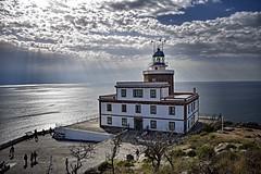Fin del Camino, Fin del Mundo (Jocelyn777) Tags: clouds sky seascapes landscapes lighthouse ocean atlanticocean fisterre finisterre caminodesantiago galicia spain travel