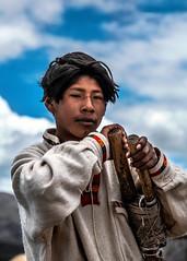 Titicaca's boatman (Roberto Farina Travel Photography) Tags: peru boatman boy titicaca latinamerica