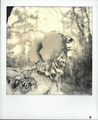 Vancouver Lovers (gooey_lewy) Tags: vancouver lovers statue padlock art display interactive canada key heart polaroid sx70 instant film photo photography sx 70 road sky black white mono couple intimate love locked