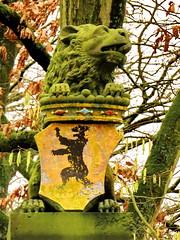 Lion L (Mattijsje) Tags: lion lions chimera statue beeld leeuw leeuwen oprijlaan laan lawn tree trees weapon wapen de geer oudegein nieuwegein green groen mos aanslag beuk beuken beech stone steen moss algen algues tongue tong