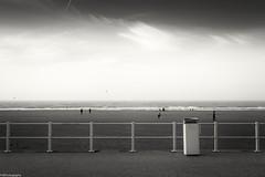 garbage can (fhenkemeyer) Tags: clouds sky bw hff garbagecan fence beach netherlands denhaag scheveningen