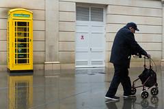 A Sudden Downpour - Bath Spa (stevedexteruk) Tags: bath bathspa uk england rain wet pavement defibrillator box kiosk telephone phone walking frame street 2019