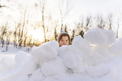 Let the snowballs come (Elizabeth Sallee Bauer) Tags: feburary active boy bright child childhood cold colorful extremeweather family fantasy flags fun happiness imagination kid makebelieve outdoors outside playing pretend snow snowfort together winter youth