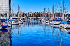 Al Port Olimpic (Fnikos) Tags: port puerto porto harbor harbour sea seascape water waterfront mar sky skyline boat sailboat ship building tower architecture tree palmtree nature construction vehicle light blue reflection outdoor