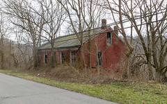 Mouser House — Ripley, Ohio (Pythaglio) Tags: house dwelling ripley ohio unitedstatesofamerica us residence historic 15story brick fivebay doublepile german mouser abandoned vacant overgrown browncounty hillside trees slope transom rakeboards 11windows sills