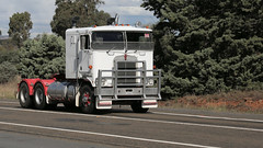 The White Kenworth (1/3) (Jungle Jack Movements (ferroequinologist)) Tags: kenworth sar k124 ken kenny kw k100 highway hauling haulin hume sydney 2019 yass classic historic vintage veteran hcvca vehicle run hp horsepower big rig haul haulage freight cabover trucker drive transport delivery bulk lorry hgv wagon nose semi trailer deliver cargo interstate articulated load freighter ship move roll motor engine power teamster tractor prime mover diesel injected driver cab wheel