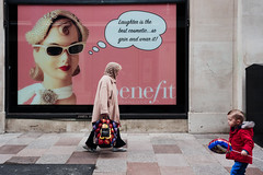 Grin and Wear (stevedexteruk) Tags: cardiff wales billboard poster 2019 balloon boy laughter cosmetic shopping