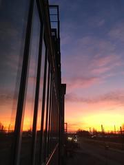 Feierabendrot (guenther_haas) Tags: abendrot eselsberg ulm sunset germany deutschland iphone se uni universität reflexion windows fenster fensterfront evening abend feierabend strassenbahnlinie strassenbahn alberteinsteinallee linie2 sky clouds himmel wolken