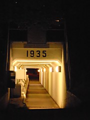 1935 (Foxie Foxxo) Tags: night nightphotography illuminate light nightlight nightlife tunnel city history lumiere nuit gold black orange street sony nacht noche ligero calle straat rue licht noir zwart historia stripe stripes striped numbers shadows