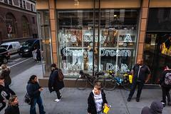 Its Only a Crazy Dream (Jocey K) Tags: sonydscrx100m6 triptocanadaandnewyork hoponhopoffbus architecture buildings window shop bikes reflections cars vans autumn people