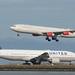United 777 -200 N768UA waiting, SAS A340 -300 OY-KBA landing, runways 28, SFO  DSC_0138