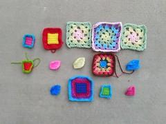Fourteen crochet remnants where there had been fifteen (crochetbug13) Tags: crochet crocheted crocheting crochetremnants crochetsquares grannysquares crochetblanket crochetafghan