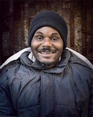 Hilton (mckenziemedia) Tags: homeless homelessness entrepreneur chicago city urban street streetphotography portrait portraiture people face smile stockingcap hat winter coat man