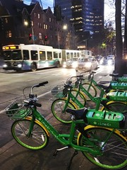 Lime bikes, bus, and cars on 4th Ave downtown (Seattle Department of Transportation) Tags: seattle sdot transportation seattlesqueeze squeeze bus transit lime bikes bikeshare downtown limee electric