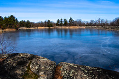 Blue Reflections (Northern Wolf Photography) Tags: 14140mm 14mm blue clouds em5 forest ice middlesexfells olympus pond reflection reservoir rocks sky statereservation trees woods stoneham massachusetts unitedstatesofamerica us