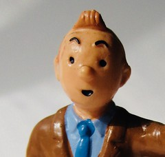 Tintin Portrait 4521 (Brechtbug) Tags: tintin plastic figure head 2010 snowy dog comics cartoon character by herge comic strip action from belgium french toy toys statue sculpture tin captain haddock run running trench coat