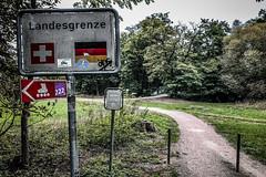 Landesgrenze (Melissa Maples) Tags: basel switzerland europe apple iphone iphonex cameraphone riehen autumn text sign woods park german deutsch landesgrenze path border bordercrossing