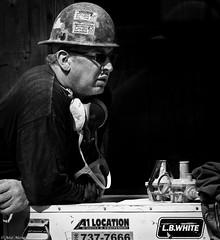 Am I safe ? (Neil. Moralee) Tags: canadaneilmoraleenikond7100 neilmoralee man work construction industry safe safety helmet hat hard dust mask worker machine workplace danger building canada montreal quebec neil moralee nikon d7100 candid street black white bw bandw blackandwhite mono monochrome
