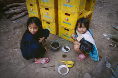 Mud Cakes (toastal) Tags: laos luangprabang child children cooking cute girl girls pretend squatting