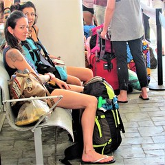 Waiting for the ferry (thomasgorman1) Tags: people women terminal sitting waiting ferry isla mexico yucatan public candid street streetphotos styreetshots canon travel tourisn backpack tattoo woman