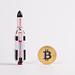 Golden Bitcoin with rocket ship