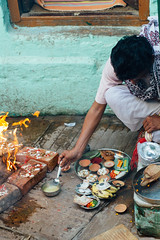 Making Offerings, Varanasi India (AdamCohn) Tags: adam cohn ganga ganges india uttarpradesh varanasi alley alleyway blessing fire pooja prayer puja ritual streetphotographer streetphotography wwwadamcohncom adamcohn
