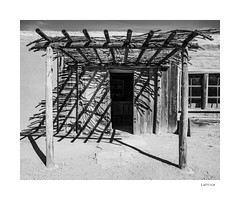 Lattice (agianelo) Tags: western porch wood post pole shadow monochrome bw bn blackandwhite
