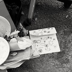 [cartescarti] (robra shotography []O]) Tags: waste strada stradale street town city paper carta foglio sheet degrado urbano urban decay writing latin pavement mobile bw bn road