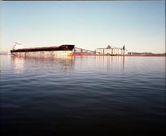 Grain dock and freighter at anchor (Kent C.) Tags: mamiyarb67pros mediumformatfilm mediumformat 6x7 kodakportra400