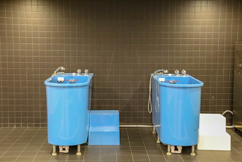 Ice bath in blue bathtubs for recovery sessions after soccer training, exhibited at the Camp Nou Stadium Tour & FC Barcelona Museum, Spain