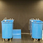 Ice bath in blue bathtubs for recovery sessions after soccer training, exhibited at the Camp Nou Stadium Tour & FC Barcelona Museum, Spain thumbnail