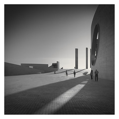 Behind the Shadow III (Vesa Pihanurmi) Tags: architecture streetphotography shadow pillars columns champalimaudcentre lisbon lisboa portugal people characters figures citiesarenovels streetsarestories