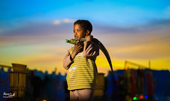 Nubian Boy (Hossam Ghaith) Tags: yellow child kide lighting canon ef 85mm f18 usm eos 6d nubia nubian sky sunset crocodile animal aswan egypt travel color landscape portrait godox speedlite 860 ii boy sun sundown background look nature brave adventure this is people hossam ghaith