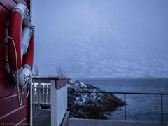 Sometimes It Snows In April (katrin glaesmann) Tags: lofoten norwegen norway 2019 wwwicelandtoursnet nordland winter sea unterwegsmiticelandtours photographyholidaywithicelandtours reflection mountains snow clouds redhut woodenhut safetybuoy