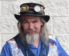 Steampunk Symposium 2019: Portrait (sharon'soutlook) Tags: portrait man male beard goggles smile blue outdoors steampunksymposium cincinnati oh 2019 naturallight