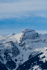 Calm (edgar_t) Tags: mountain snow switzerland sky alps clouds blue trees