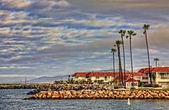 O'Side Marina Inn 13-3-7-19 (rod1691) Tags: oceanside california harbor marina inn jetty paltrees clouds canon50d