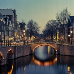 Amsterdam Canals (angheloflores) Tags: amsterdam cana houses bridge lights night photography longexposure cityscape hasselblad hasselblad500cm kodakektar film analoge 6x6 mediumformat city street clouds sky colors travel architecture europe netherlands holland