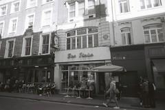 Bar Italia (goodfella2459) Tags: nikonf4 afnikkor24mmf28dlens kodaktmax100 35mm blackandwhite film analog london soho baritalia cafe history buildings bwfp manilovefilm