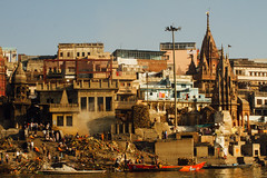 Manikarnika Ghat from Ganges River, Varanasi India (AdamCohn) Tags: adam cohn adamcohn ganga ganges gangesriver hindu india uttarpradesh varanasi dawn funeral funerary ghats morning pyre streetphotographer streetphotography sunrise wwwadamcohncom मणिकर्णिकाघाट