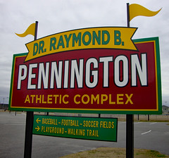 Sign At Pennington Athletic Complex. (dccradio) Tags: lumberton nc northcarolina robesoncounty outdoor outside outdoors park citypark northeastpark drraymondbpenningtonathleticcomplex penningtonathleticcomplex january winter saturday saturdayafternoon afternoon goodafternoon sony cybershot dscw230 sky overcast cloudy flag flags yellowflag sign words text color colorful baseball football soccer playground walkingtrail
