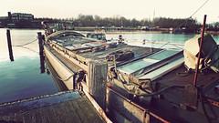 P1070194vf (hans hoeben) Tags: thewaiting abandonedbargeneartheformeradmterrain amsterdamholland adm terrain former abandoned barge amsterdam holland harbor west exit